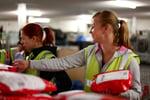 Asendia woman sorting